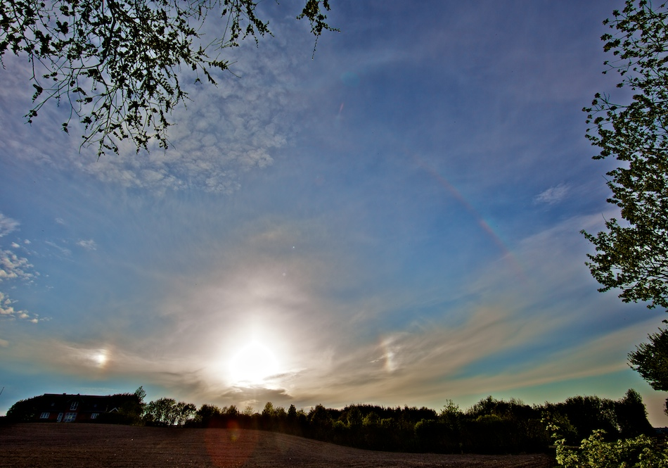 Colorful supralateral arc and sundogs.